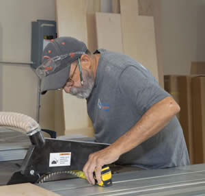 Mike Checks Dimensions For Perfect Fit - Sunset Custom Cabinetry and Woodwork - Fort Myers FL - 300 x 286